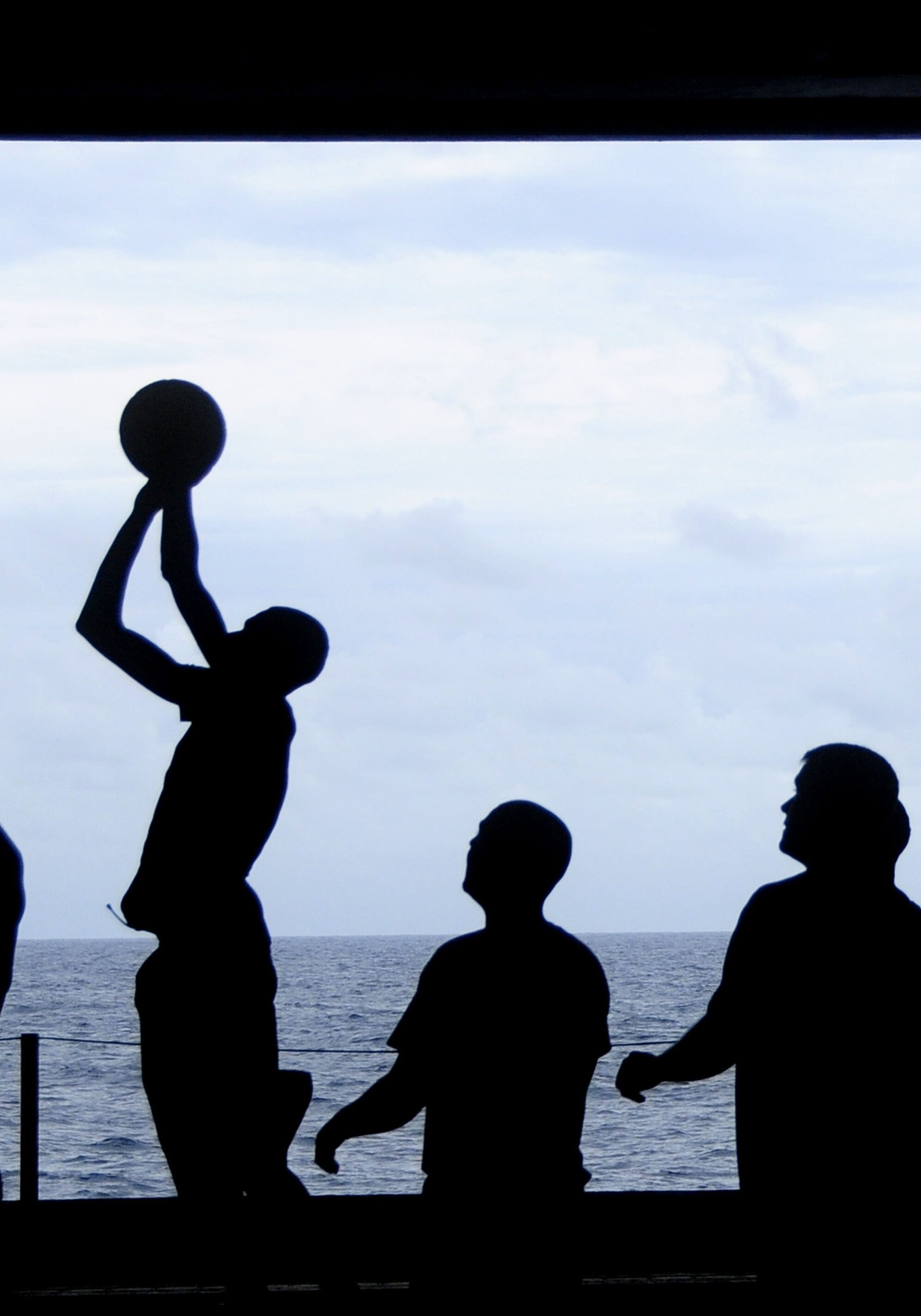 silhouette-of-men-playing-basketball-69773